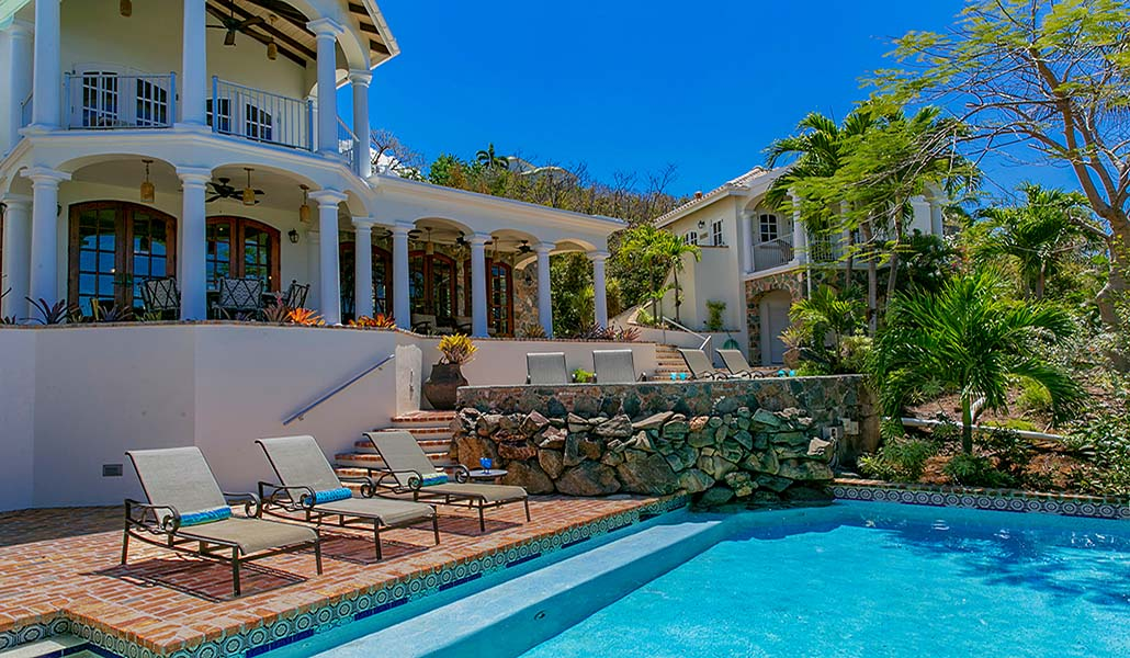 The stately Las Brisas Caribe main house overlooks a spacious and elegant pool patio.